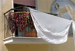 Chiles and linen drying on a balcony
