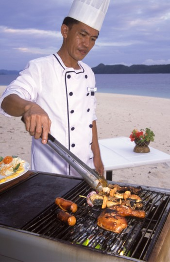 Chef Grilling on the Beach