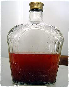 BBQ sauce in a Crown Royal Bottle