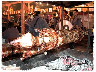 The trubachis serenade a whole hog being barbecued