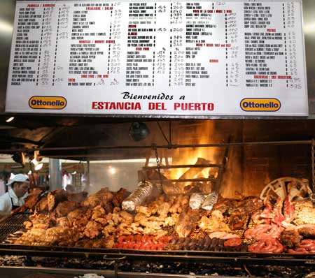 A typical mercado menu describes various cuts with prices.