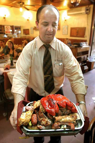 A waiter holding a typical