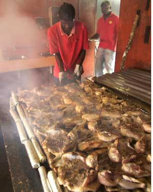 Jerk Chicken being Grilled