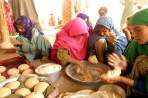 Afghani women preparing bread.