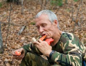 Man Eating Pepper