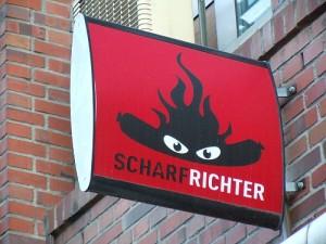Scharfrichter logo in Bremen: a sausage with a devilish flaming hot-spicy sauce
