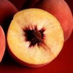 Grilled Peach Halves Stuffed with Cheese and Chipotle Raspberry Puree
